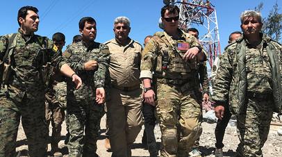 Военные США и бойцы курдских отрядов народной самообороны YPG