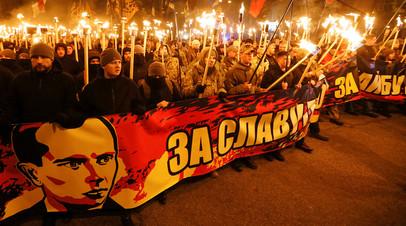 Активисты украинских националистических партий во время митинга, посвящённого 109-й годовщине со дня рождения Степана Бандеры в Киеве, Украина