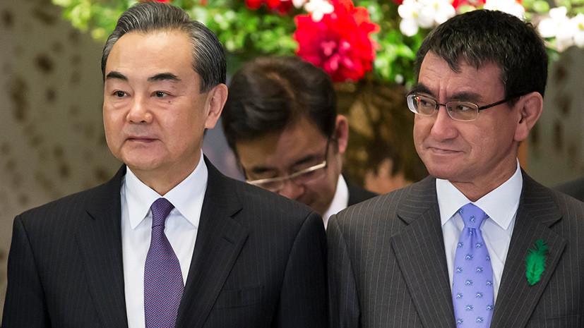 Главы МИД Китая и Японии выступили в защиту принципов ВТО