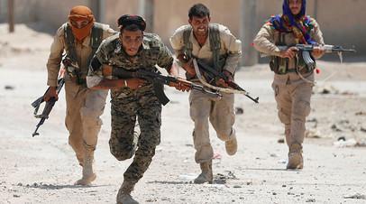 Бойцы курдских Отрядов народной самообороны (YPG) ©Reuters
