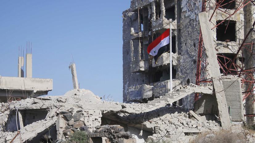 Армия подняла флаг Сирии на площади, с которой начались протесты в 2011 году