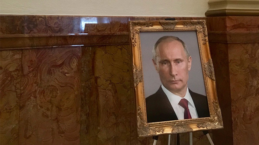 СМИ: Неизвестный разместил фото Путина на месте для портрета Трампа в капитолии Колорадо