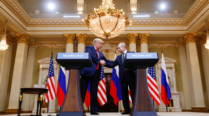 Владимир Путин и Дональд Трамп © Kevin Lamarque