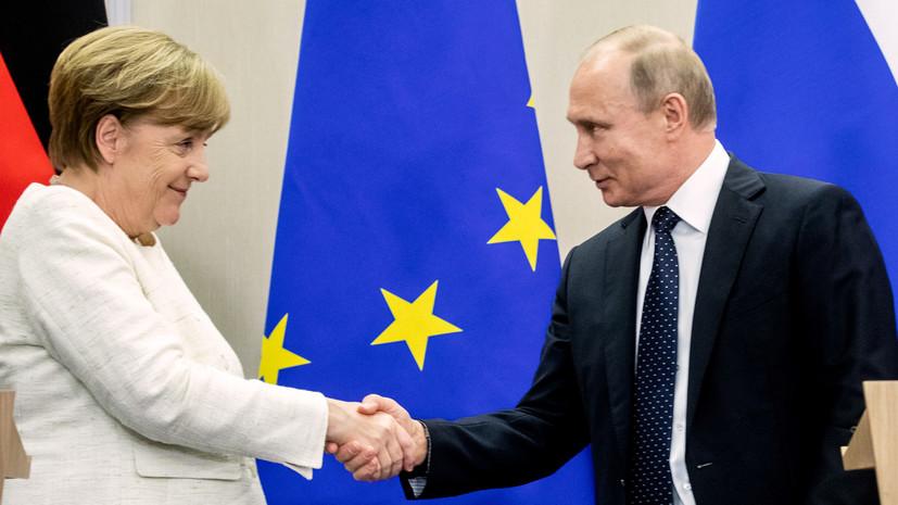 Российский лидер Владимир Путин и канцлер ФРГ Ангела Меркель во