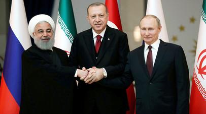 Президент РФ Владимир Путин, лидер Турции Реджеп Эрдоган и глава Ирана Хасан Рухани во время встречи в Анкаре