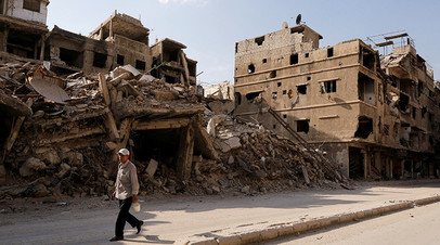 Улица в Дамаске, разрушенная в ходе конфликта в Сирии