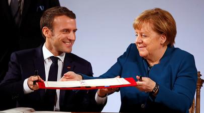 Ангела Меркель и Эммануэль Макрон подписывают Ахенское соглашение