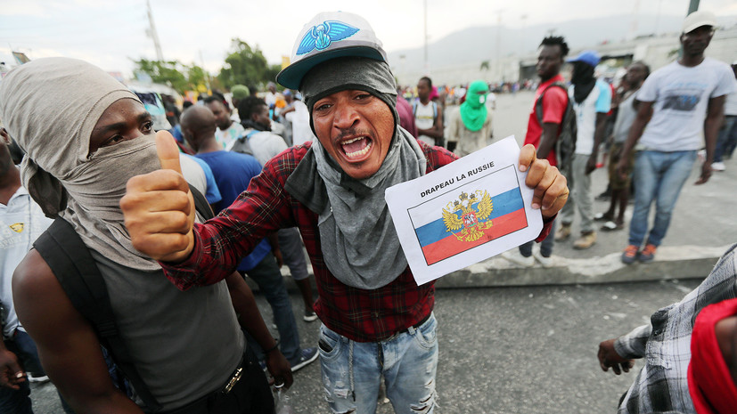 Протестующие в Гаити сожгли флаг США и призвали Россию на помощь