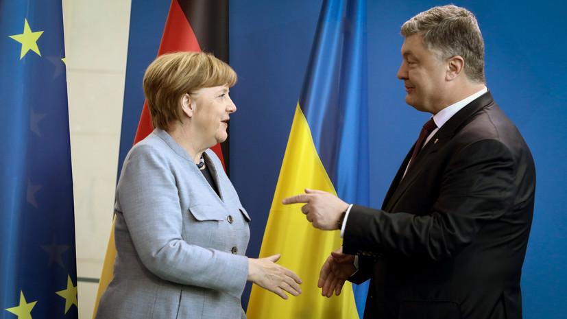 Меркель поздравила Порошенко с выходом во второй тур выборов