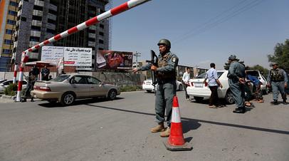 Сотрудник афганской полиции на улице в Кабуле