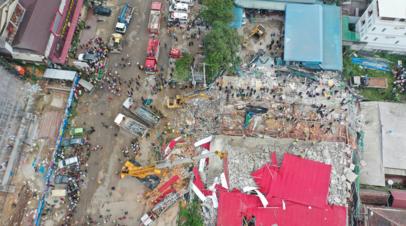 Число жертв обрушения здания в Камбодже увеличилось до 18 человек