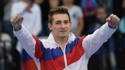 Гимнаст Белявский получил золото ЕИ-2019 из рук президента МОК Баха