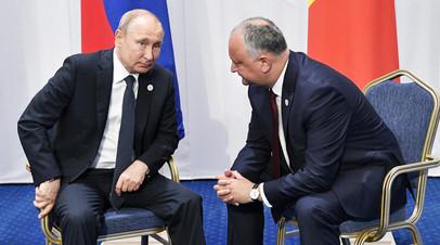 Президент России Владимир Путин и президент Молдавии Игорь Додон во время встречи в Нур-Султане