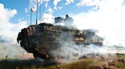 Американские военнослужащие и техника во время учений в Прибалтике