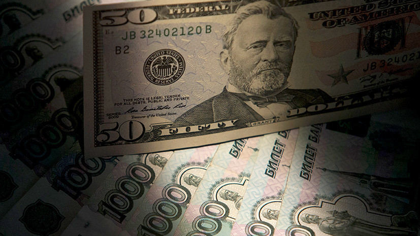 Печатный сбой: курс доллара США впервые с начала месяца опустился ниже 64 рублей