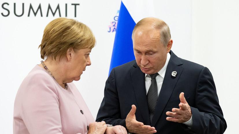 Путин и Меркель в беседе затронули тему разведения сил в Донбассе