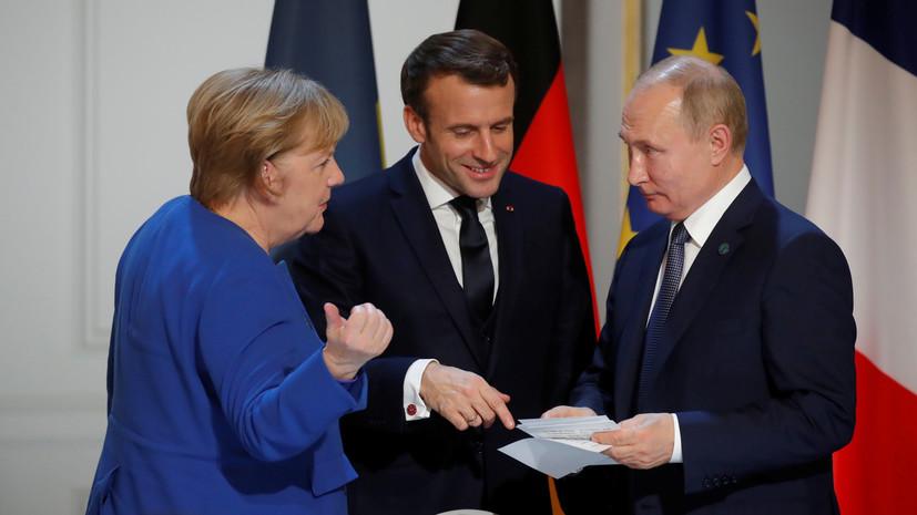 «Коммерсантъ»: Меркель в Париже назвала Путина победителем