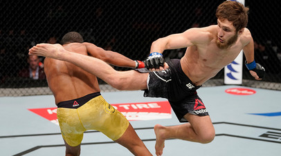 BUSAN, SOUTH KOREA - DECEMBER 21: (R-L) Said Nurmagomedov of Russia kicks Raoni Barcelos of Brazil in their bantamweight fight during the UFC Fight Night event at Sajik Arena 3 on December 21, 2019 in Busan, South Korea.