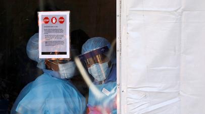 Медицинские работники в защитном снаряжении, Бруклин, 27 марта 2020
