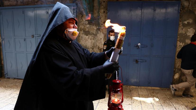 Благодатный огонь доставлен из Иерусалима в Москву