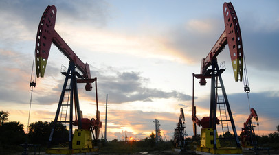 Pumpjacks are seen during sunset at the Daqing oil field in Heilongjiang province, China