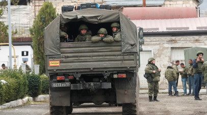 Russian peacekeepers sit in a military truck forces near Stepanakert in the region of Nagorno-Karabakh, November 13, 2020.