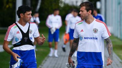 Юрий Жирков (слева) и Фёдор Смолов во время тренировки сборной России по футболу в Новогорске.