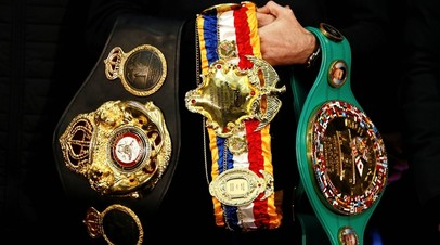 Чемпионские пояса по версиям WBC, WBA и The Ring