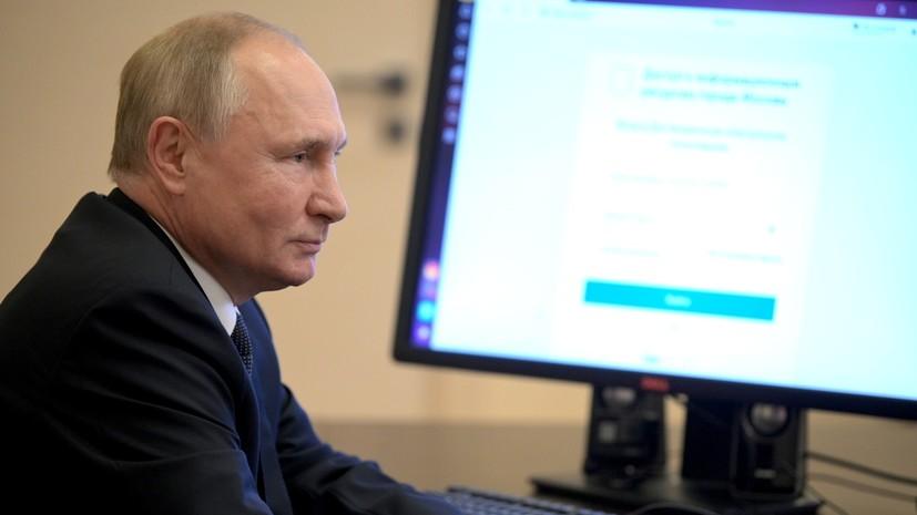 Путин проголосовал на выборах в Госдуму с телефона помощника