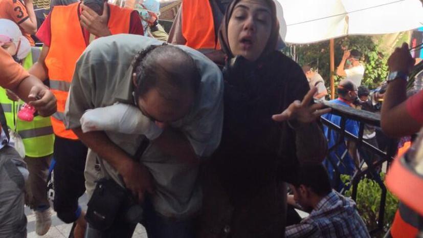 Для разгона сторонников Мурси полиция применила слезоточивый газ (ФОТОГАЛЕРЕЯ)