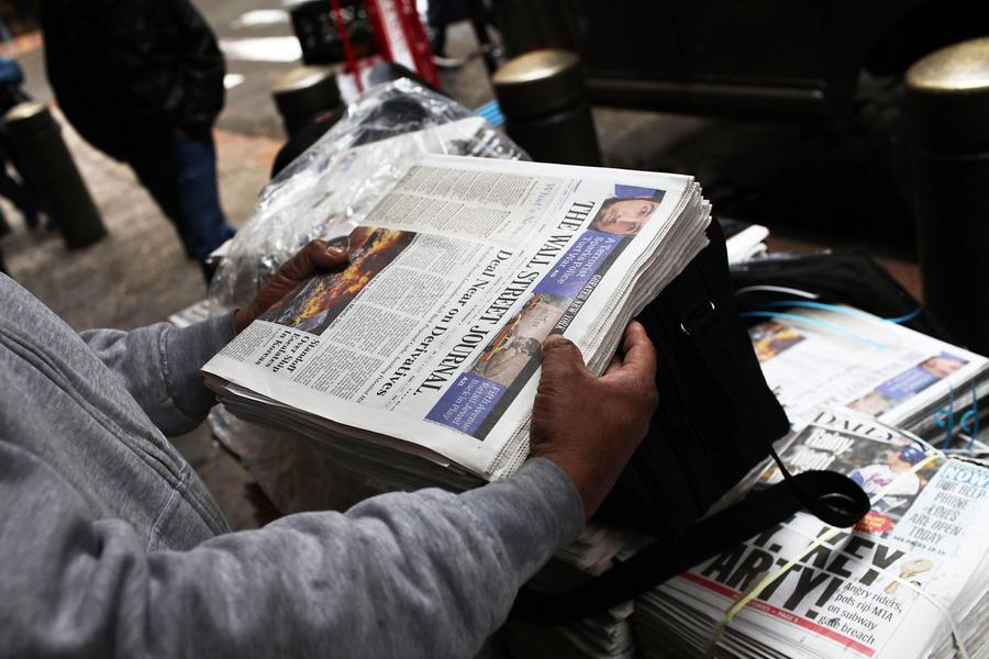 Минюст США обвиняет журналистов The Wall Street Journal в даче взяток