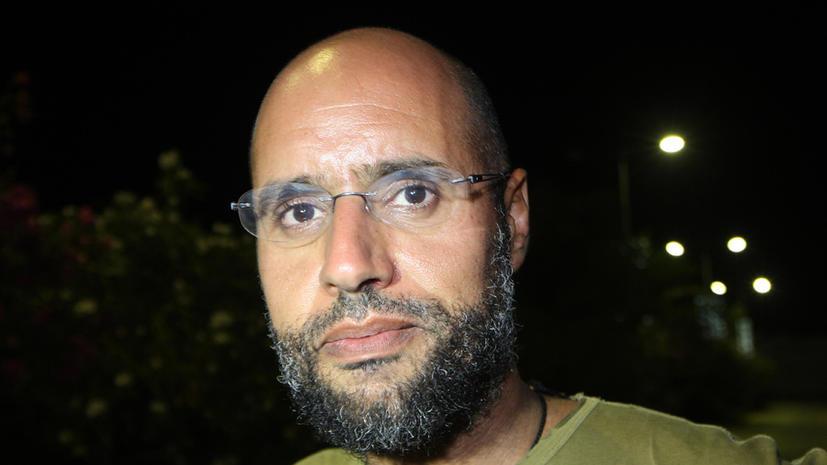 Сына Каддафи обвинили в осквернении ливийского флага