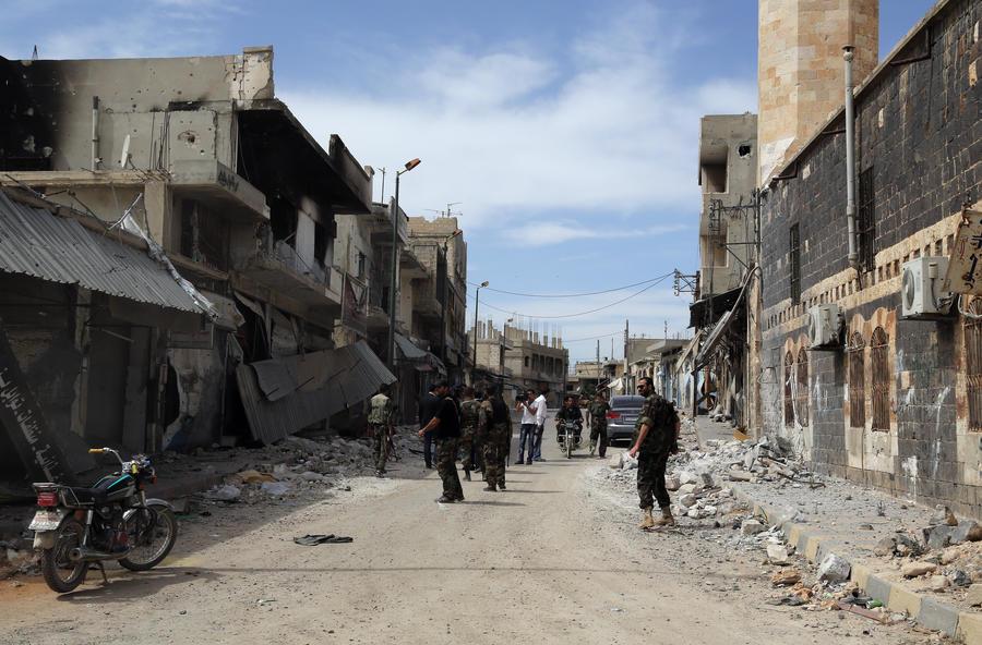Сирийские войска окружили последние оплоты боевиков оппозиции в городе Хомс