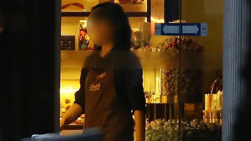 Фотогалерея: кафе в центре Сиднея, где удерживаются заложники, погрузилось во тьму