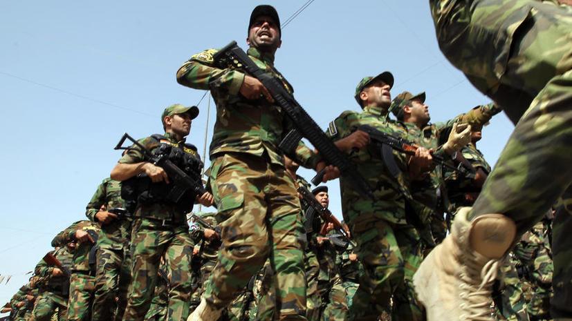 Тысячи шиитов прошли маршем по Багдаду, чтобы показать решимость противостоять атаке боевиков-суннитов