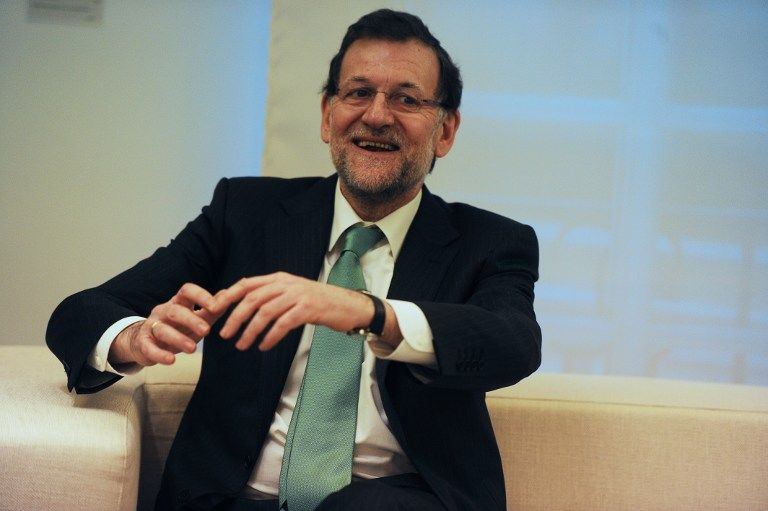 Пострадавшие от кризиса испанцы требуют отставки разбогатевшего на откатах премьера