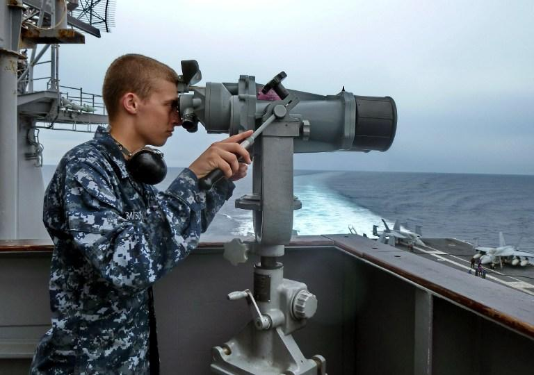 В Южно-Китайском море американский ракетный крейсер едва избежал столкновения с китайским кораблём