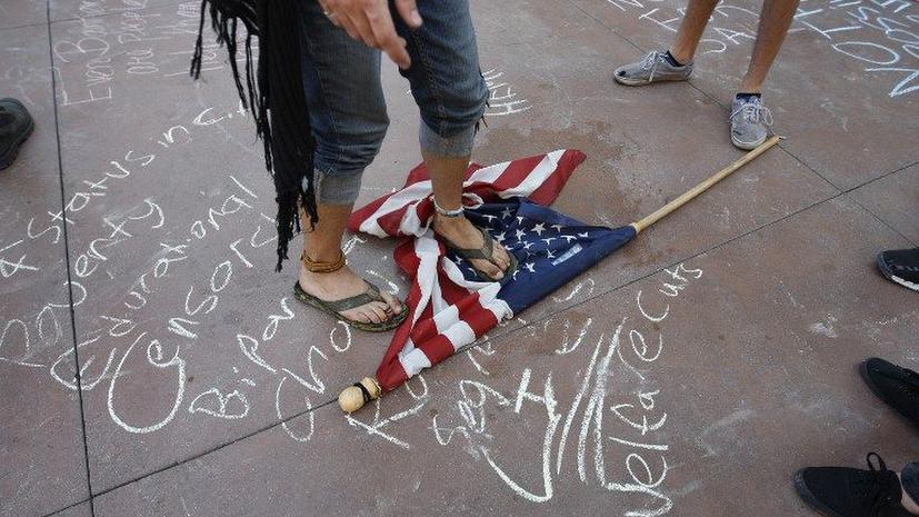 Присяжные в США оправдали участника движения Occupy, обвинявшегося  в избиении полицейского