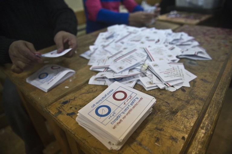 СМИ: в Египте большинство участвующих в референдуме проголосовали за принятие новой конституции
